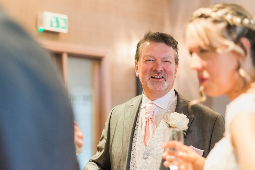 father of the groom laughs