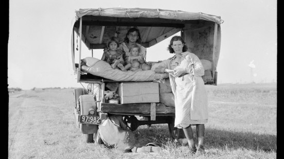 """A family traveling betweenDallas and Austin, Texas. """"The people have left their home and connections in South Texas, and hope to reach the Arkansas Delta for work in the cotton fields,"""" Lang wrote in her notes. """"Penniless people. No food and three gallons of gas in the tank. The father is trying to repair a tire. Three children. Father says, 'It's tough but life's tough anyway you take it.'"""