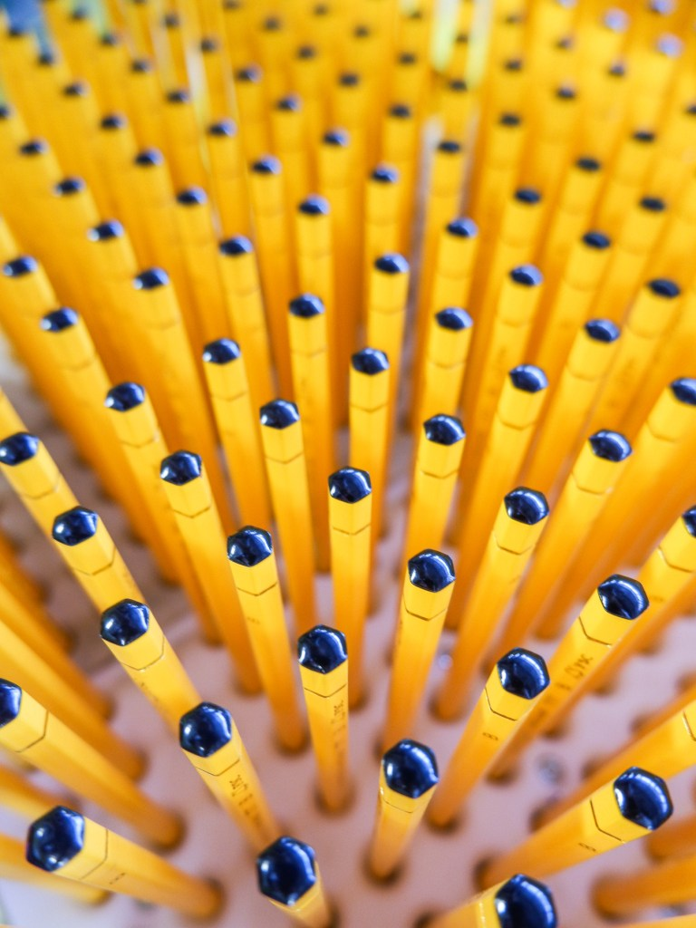 rows of yellow pencils at caran d'ache factory
