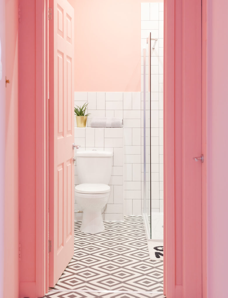 pink bathroom with monochrome patterned flooring