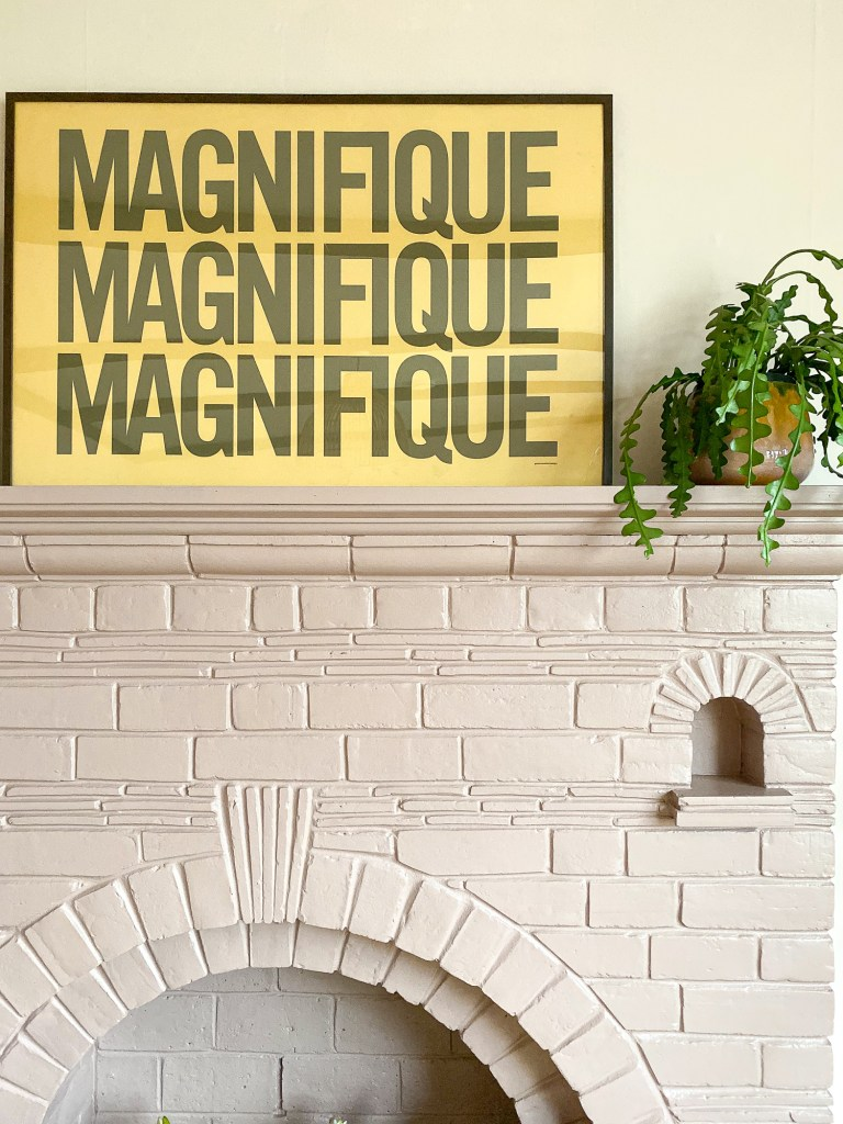 pink fireplace with yellow framed print