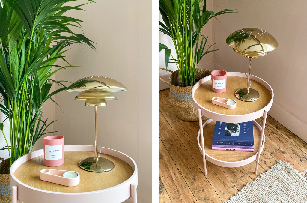 peach living room with pink side table and gold table light