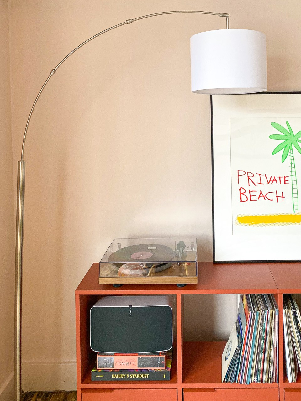 peach living room with white arched lamp