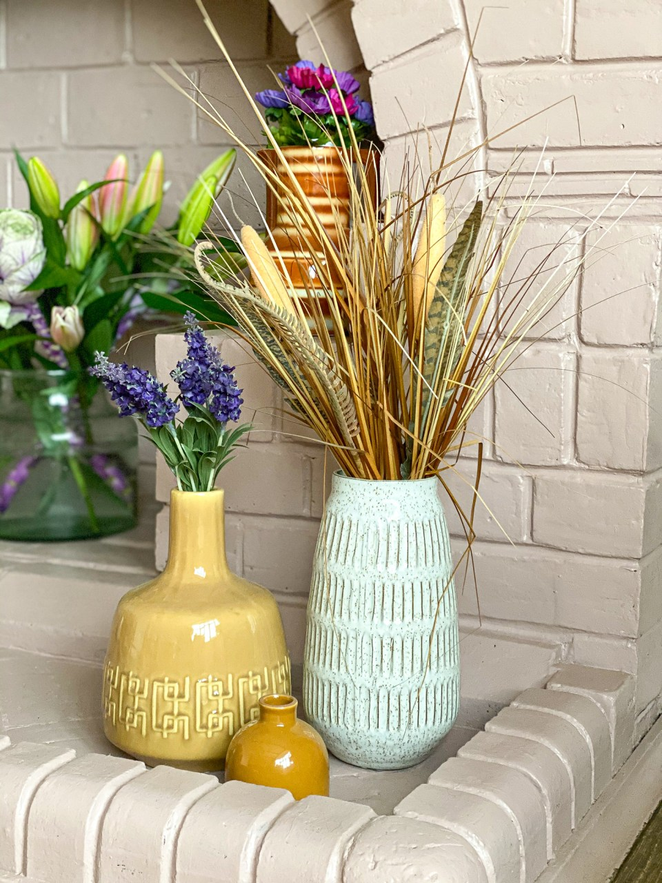 pink fireplace with yellow and white vases