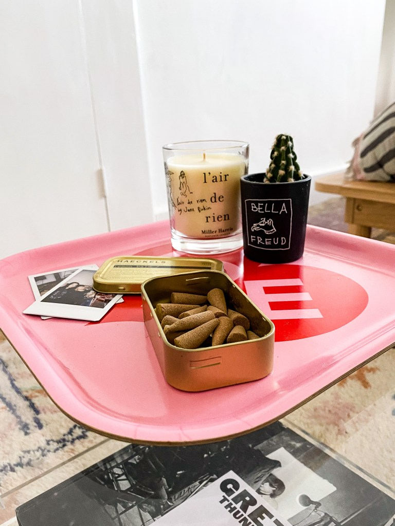 candles and incense on pink love tray