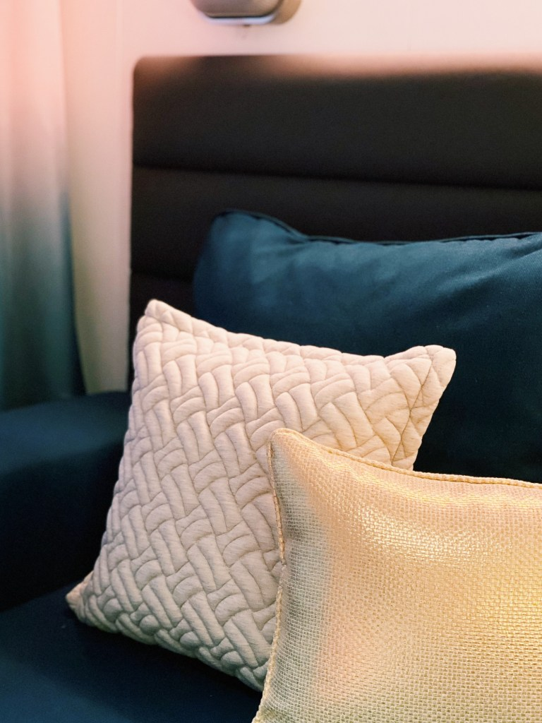 patterned cushions in virgin voyages cabin