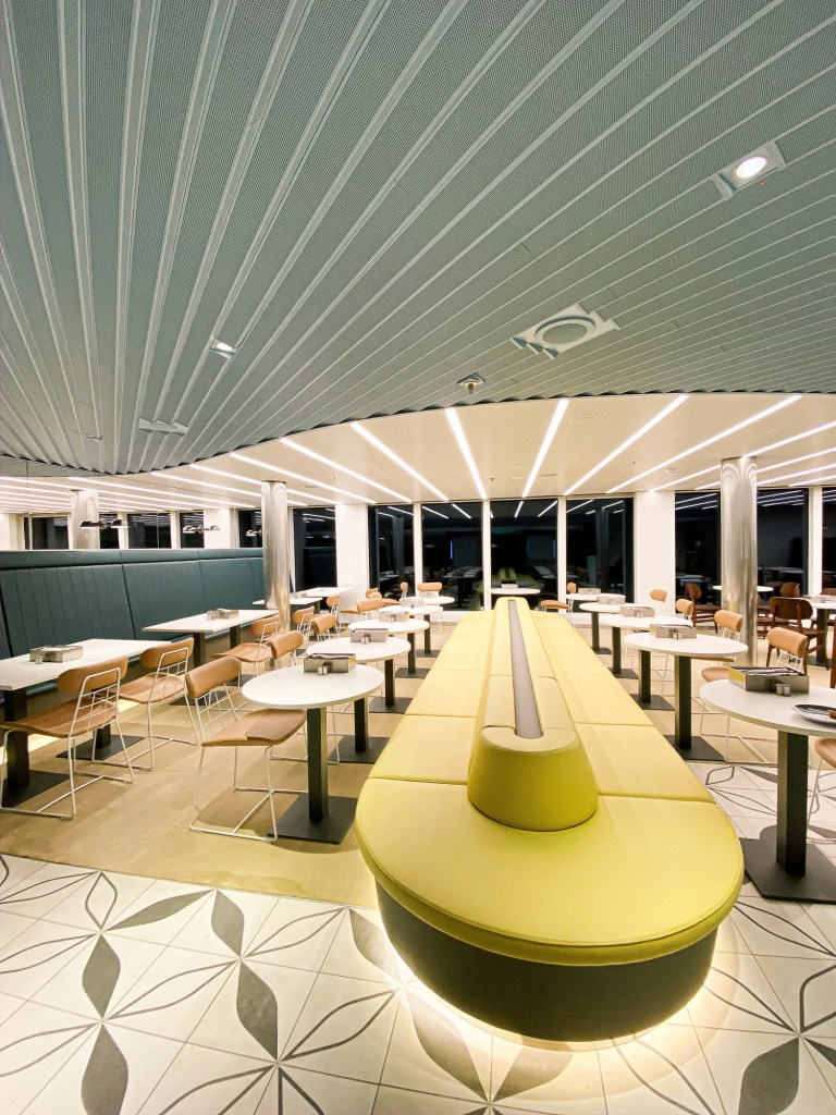 pastel retro spaceship interior in restaurant