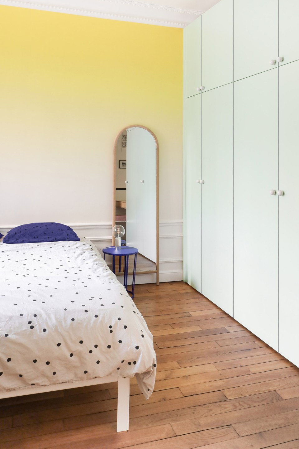 minimal bedroom with yellow ombre wall