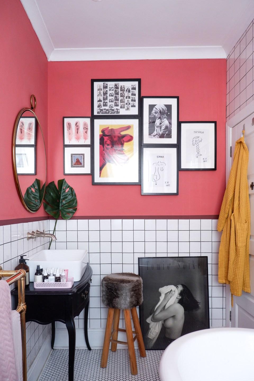 gallery wall in pink bathroom