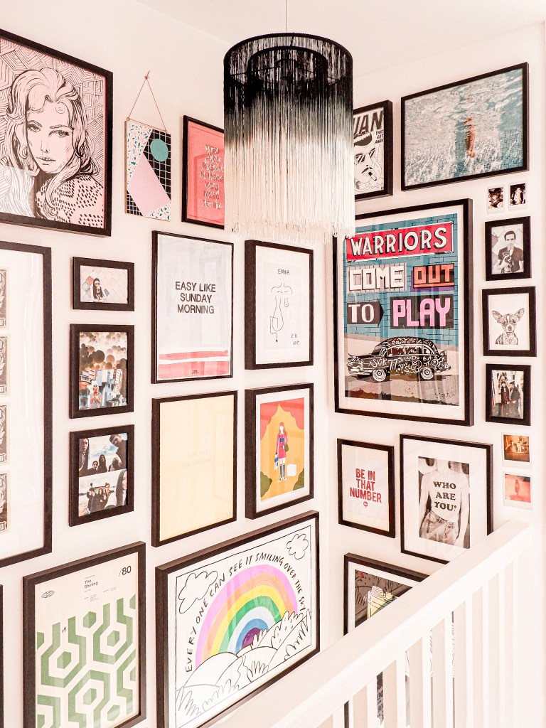 colourful gallery wall in hallway
