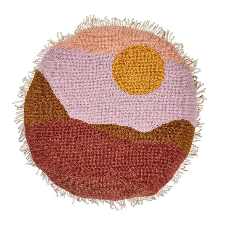sunset hued round California cushion