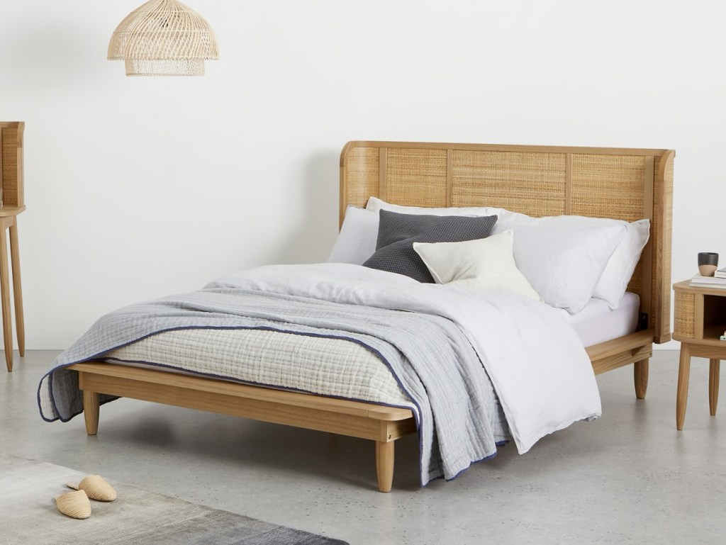 Curved wraparound rattan bed by Sebastian Cox