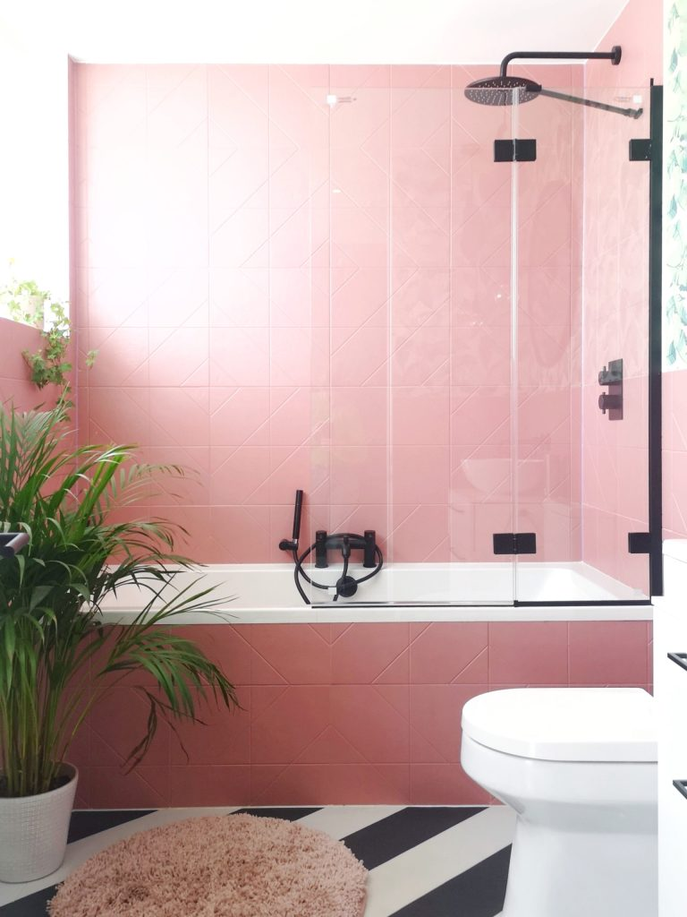 pink bathroom with black and white flooring