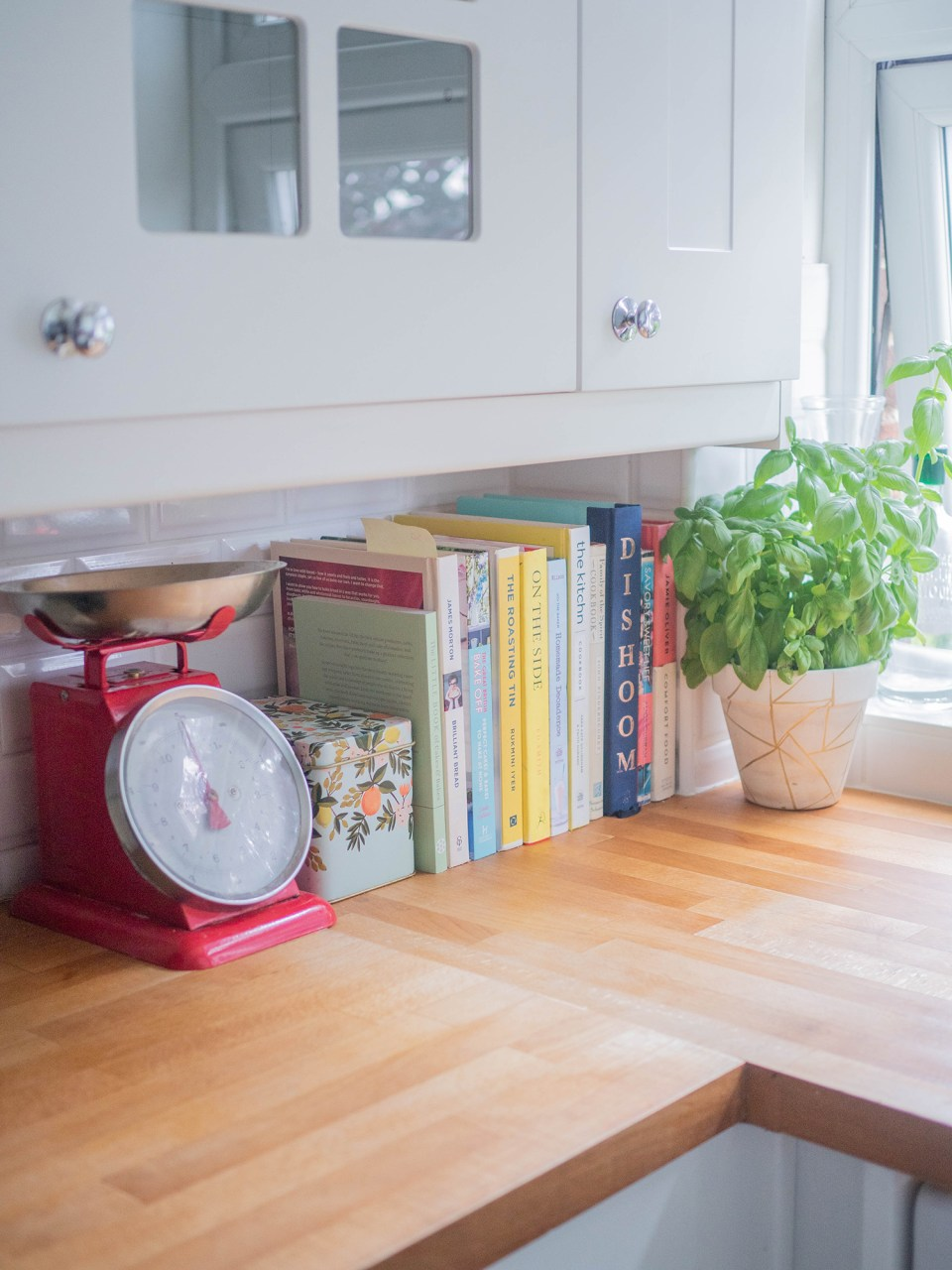 kitchen with weighing scales and cook books