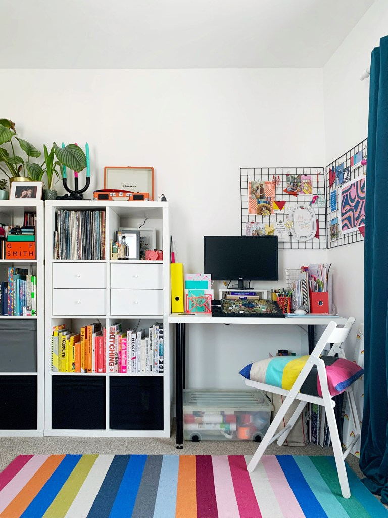 office space with white furniture and colourful decor