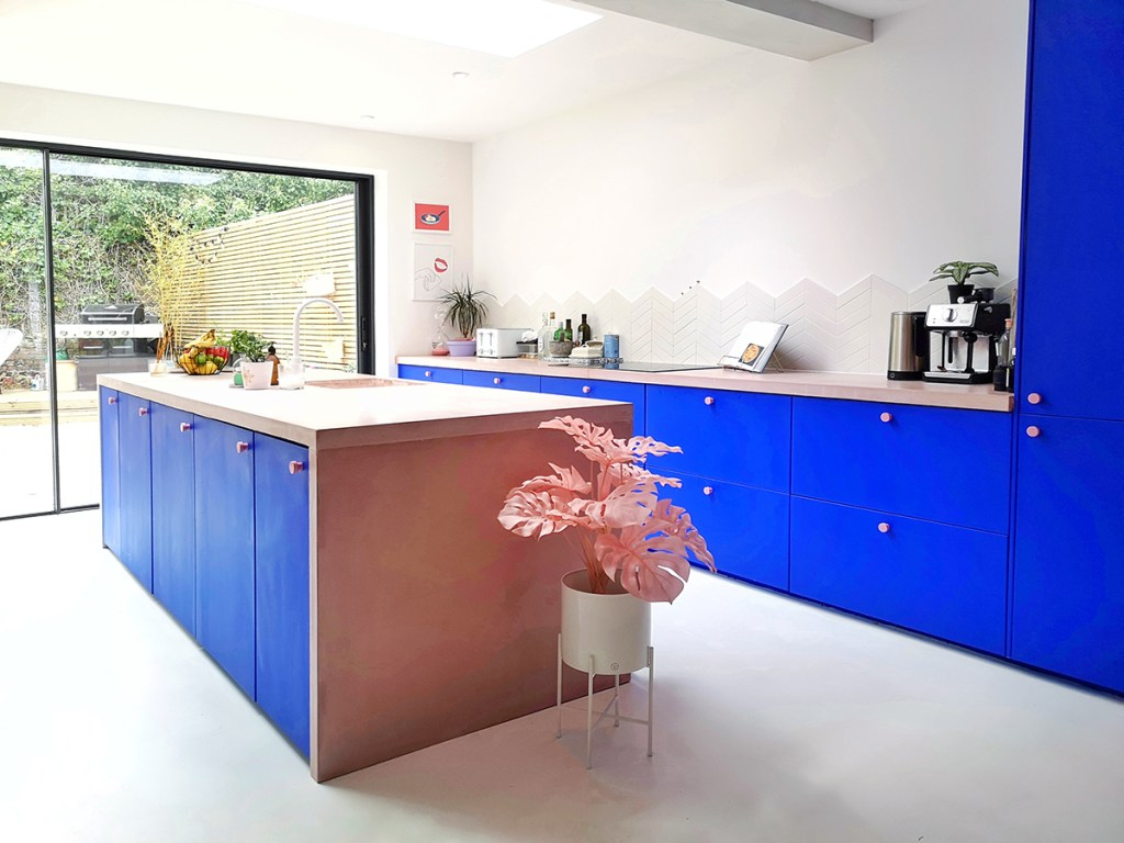 blue kitchen with plywood worktops