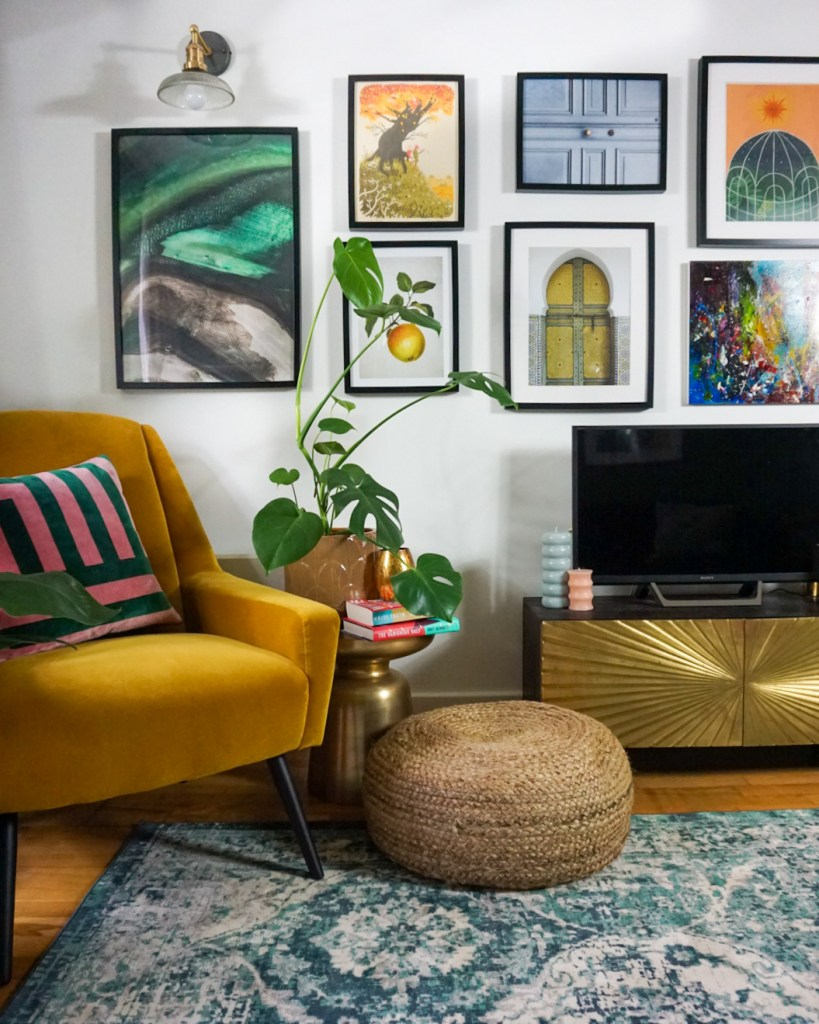 colourful gallery wall with yellow velvet chair