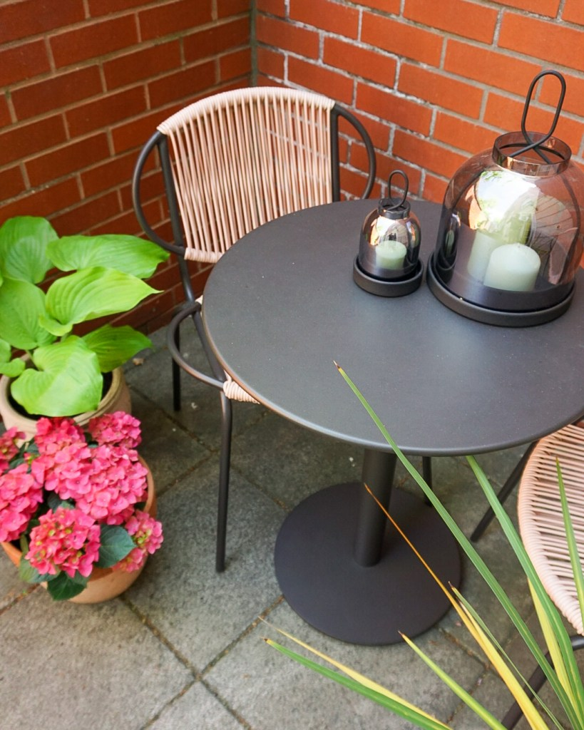 small courtyard with pink and slate garden furniture