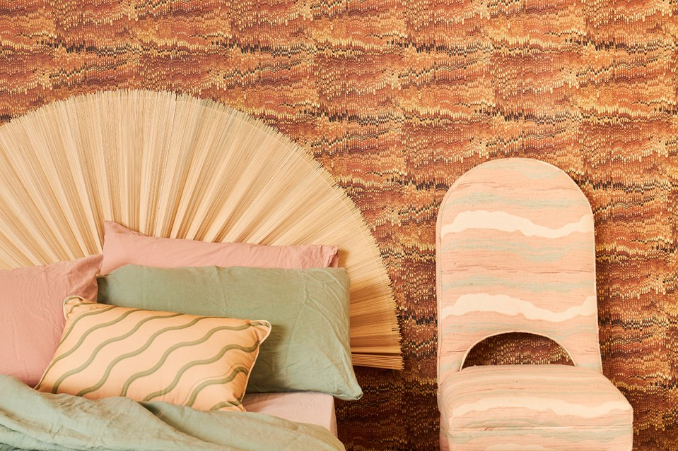 Poodle & Blonde zig zag pattern wallpaper in bedroom with woven circular headbaord