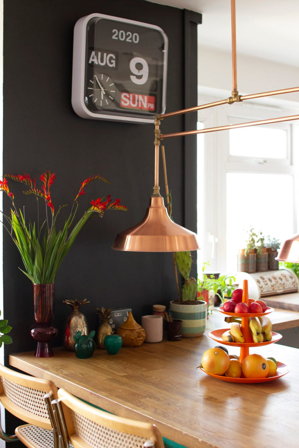 kitchen bar and cane seating with copper pendant lamp