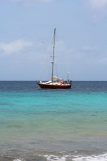 Bloodshot moored at one of the many free day moorings around the island. Tranquil scene belies dinghy walk of coral urchin death which came after