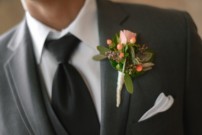 the groom's boutonniere | photo: Photos by Kristopher | via http://emmalinebride.com