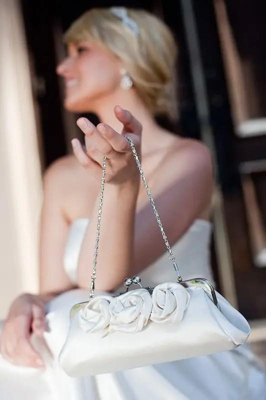 bride holding clutch purse