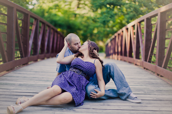 couple kissing bridge