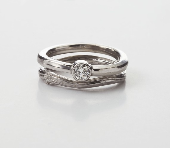 solitaire engagement ring in bezel style with twig wedding band