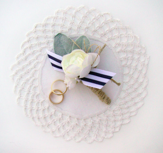 nautical boutonniere | via 50+ nautical wedding theme ideas at EmmalineBride.com