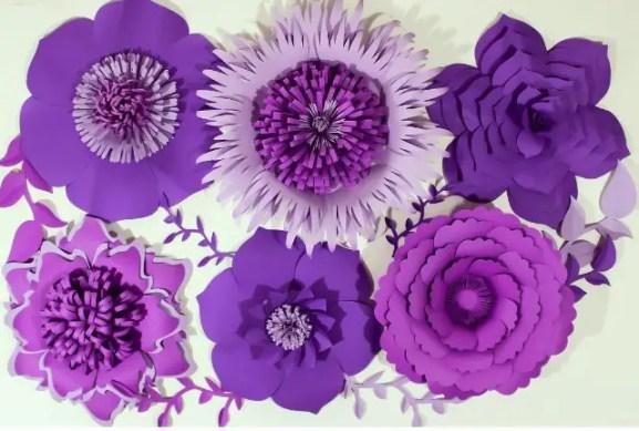 These paper flower backdrops are beautiful for weddings purple paper flower backdrop mightylinksfo