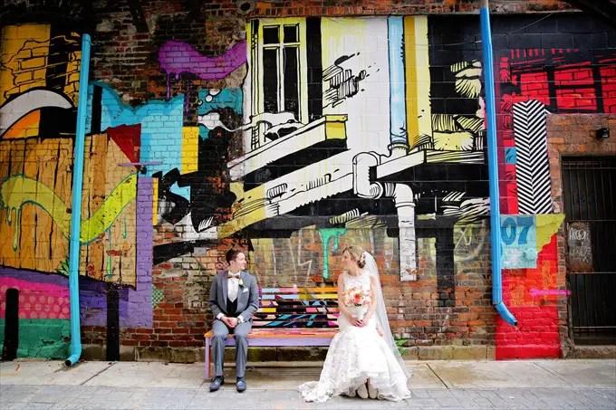 Detroit_wedding_bride_groom_art_graffiti Downtown Detroit Wedding - http://emmalinebride.com/real-weddings/a-beautiful-downtown-detroit-wedding-nick-jeannine/ | Michigan wedding photographer - The Camera Chick
