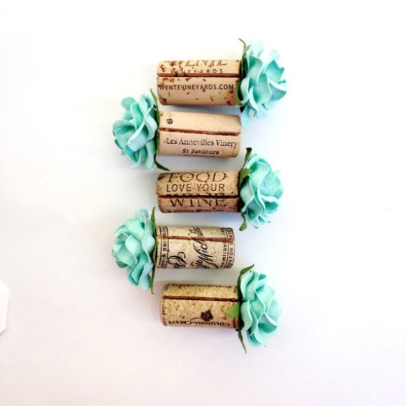 cork place card holders with aqua flowers
