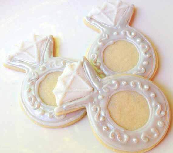 engagement ring sugar cookies by SugarMeDesserterie | via 21 Totally Fun Ring Themed Bridal Shower Ideas → http://emmalinebride.com/planning/ring-themed-bridal-shower/