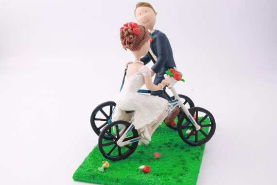 figurine cake toppers riding bikes 1