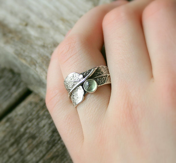 sage green ring by joannerowan | via Sage Wedding Ideas from http://emmalinebride.com/color/sage-green-wedding-ideas/