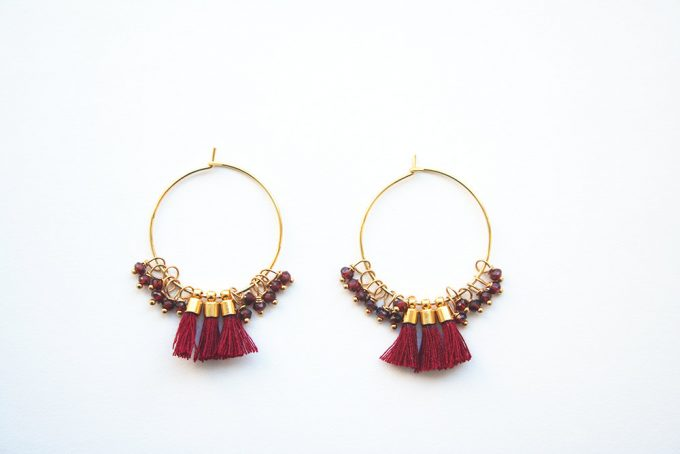 Tassel earrings by Laura Stark via 21 Festive Tassel Wedding Decorations & Accessories | http://emmalinebride.com/themes/tassel-wedding-decorations/