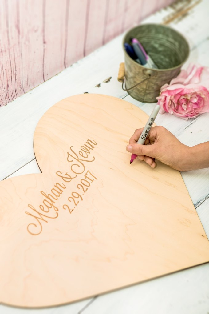 giant heart guest book | via Heart and Arrow Wedding Ideas: http://emmalinebride.com/themes/heart-and-arrow-wedding-ideas