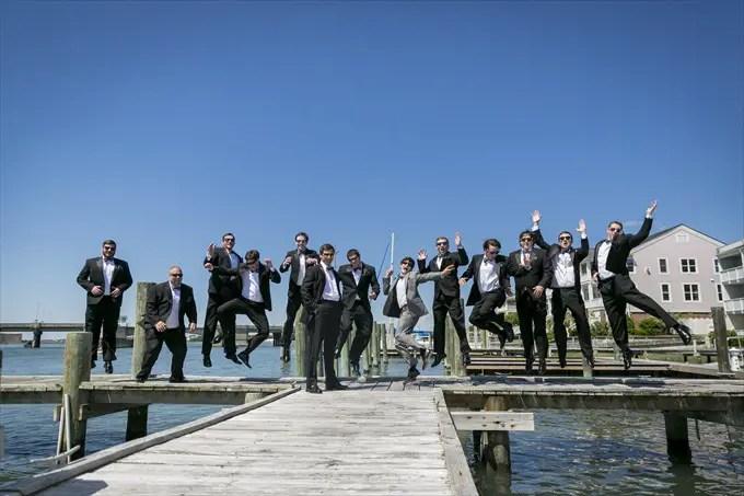 groom and groomsmen jump in this fun photograph in this Crystal Coast Wedding | North Carolina wedding photographed by Ellen LeRoy Photography - http://emmalinebride.com/real-weddings/breathtaking-crystal-coast-wedding-mara-will-married/