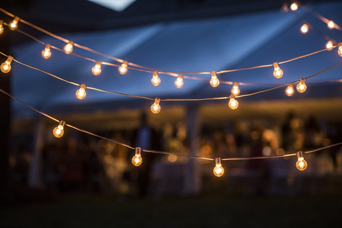 outdoor lighting at reception in this Crystal Coast Wedding | North Carolina wedding photographed by Ellen LeRoy Photography - http://emmalinebride.com/real-weddings/breathtaking-crystal-coast-wedding-mara-will-married/