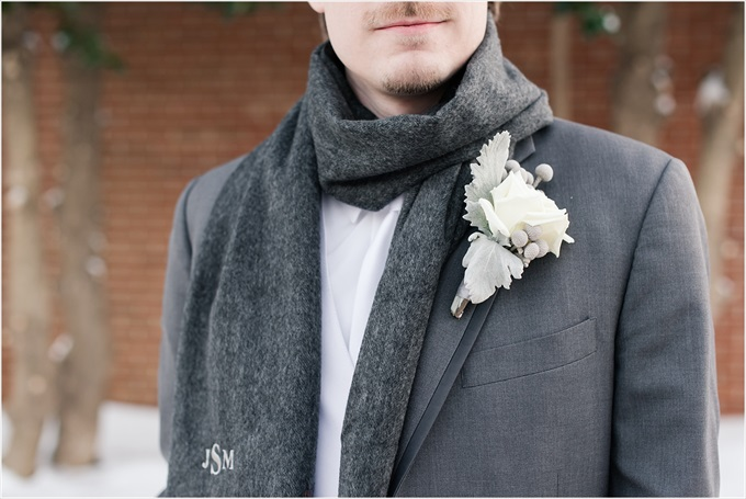 groom with custom scarf and white boutineer in this Sedgefield Country Club wedding| Greensboro, North Carolina winter wedding photographed by Michelle Robinson Photography - http://emmalinebride.com/real-weddings/sedgefield-country-club-wedding/
