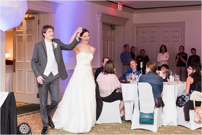 bride and groom enter reception at this Sedgefield Country Club wedding| Greensboro, North Carolina winter wedding photographed by Michelle Robinson Photography - http://emmalinebride.com/real-weddings/sedgefield-country-club-wedding/