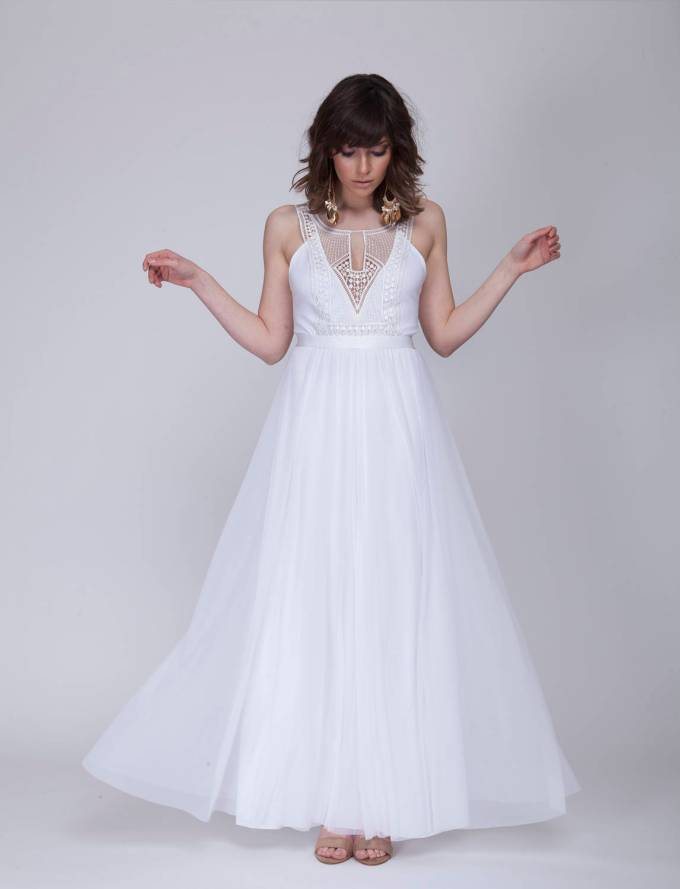 simple bohemian wedding dress with cut out design via here