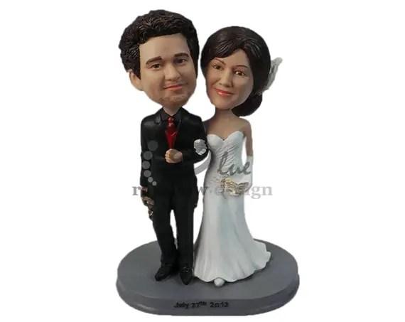 Custom Wedding Bobbleheads   http://emmalinebride.com/gifts/custom-wedding-bobbleheads/