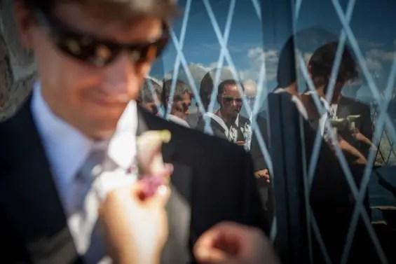 Johnstone Studios - lake tahoe wedding - boutineer is pinned to groomsman suit