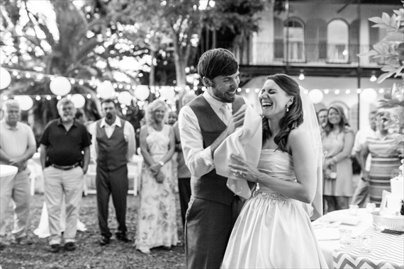 Filda Konec Photography - bride and groom laugh with wedding cake at key west wedding