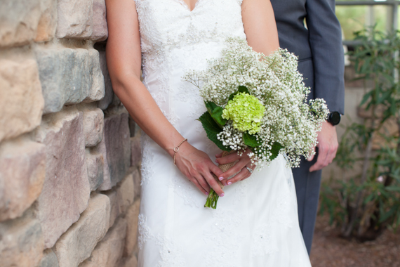 rustic chic arizona wedding with bride holding flowers