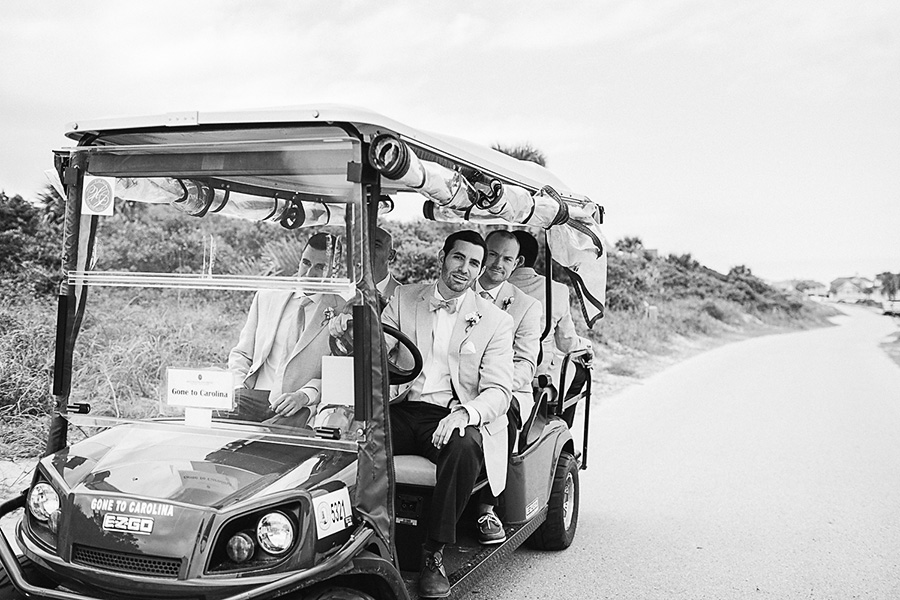 The Groomsmen Arriving at the Ceremony in Golf Cart - Bald Head Island Wedding - Photo by Eric Boneske