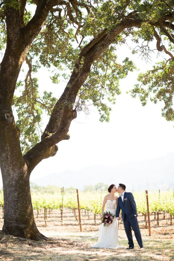 Winery Styled Wedding Shoot - The Bride and Groom Kissing in Winery