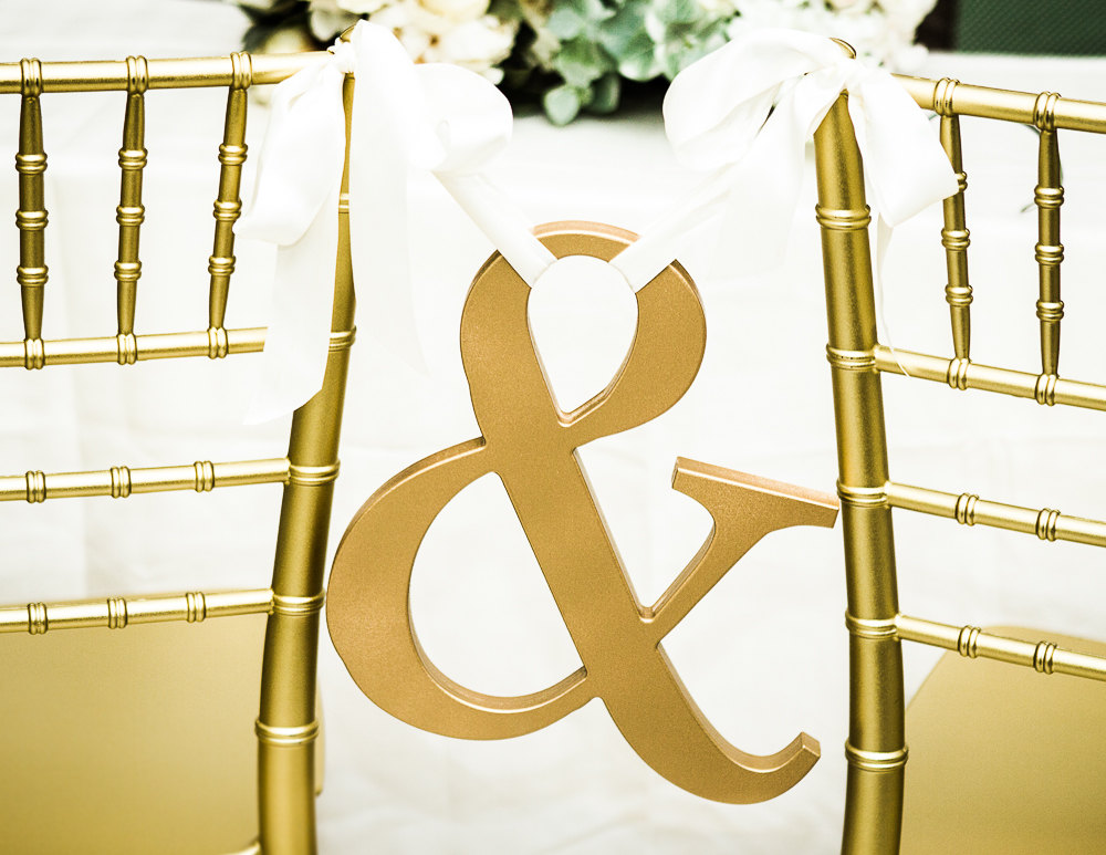 ampersand gold chair sign | via bride and groom chair signs http://emmalinebride.com/decor/bride-and-groom-chairs/